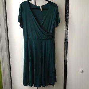 Teal faux wrap knee length dress